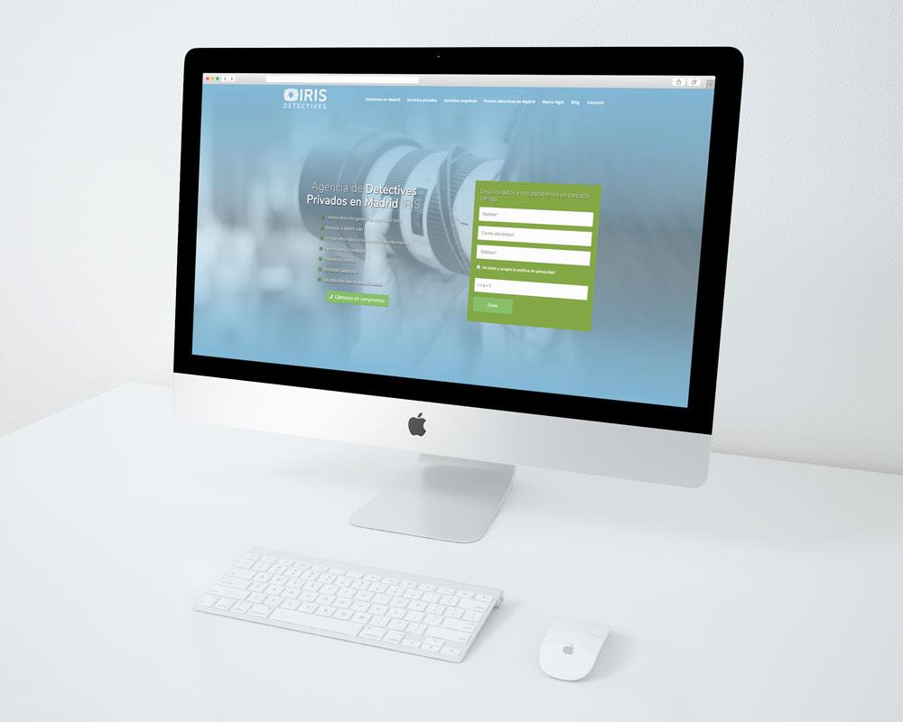 iMac mockup de la web Detectives Madrid IRIS